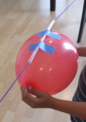 balloon attached to a straw